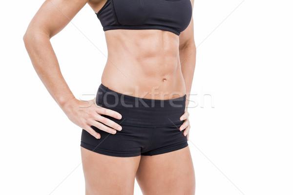 Female athlete posing with hands on hip Stock photo © wavebreak_media