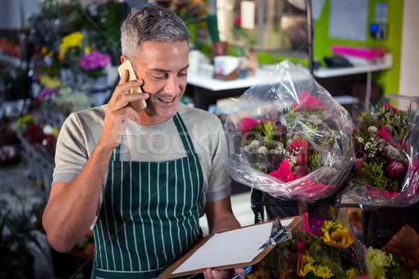 мужчины флорист порядка мобильного телефона Сток-фото © wavebreak_media