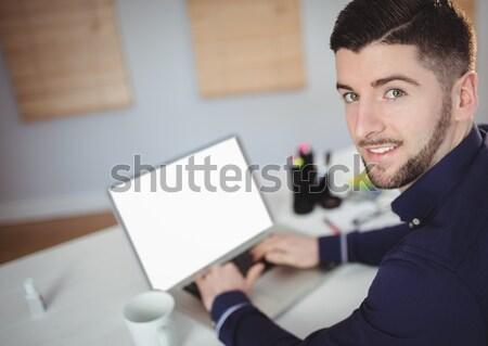 Portrait of man working in office Stock photo © wavebreak_media
