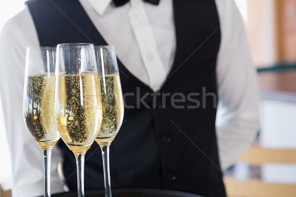 Waiter holding glasses of champagne Stock photo © wavebreak_media