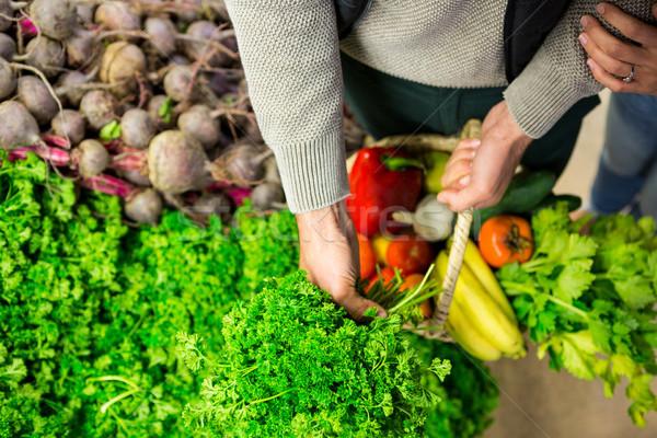 Woman selecting vegetables in organic section Stock photo © wavebreak_media
