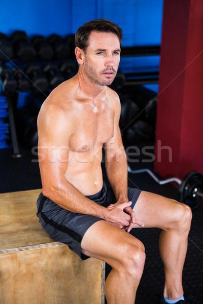 Thoughtful athlete sitting on cube  Stock photo © wavebreak_media