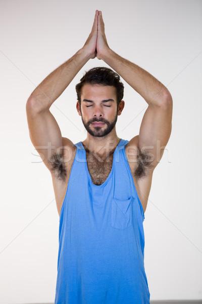 Férfi lótusz póz csukott szemmel fitnessz stúdió Stock fotó © wavebreak_media