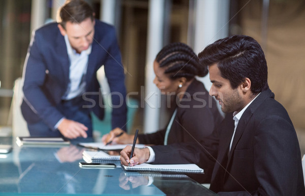 Businessman interacting with coworkers in a meeting in the conference room Stock photo © wavebreak_media