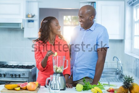 Couple standing with mixer Stock photo © wavebreak_media