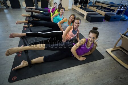 Group of smiling women performing stretching exercise Stock photo © wavebreak_media