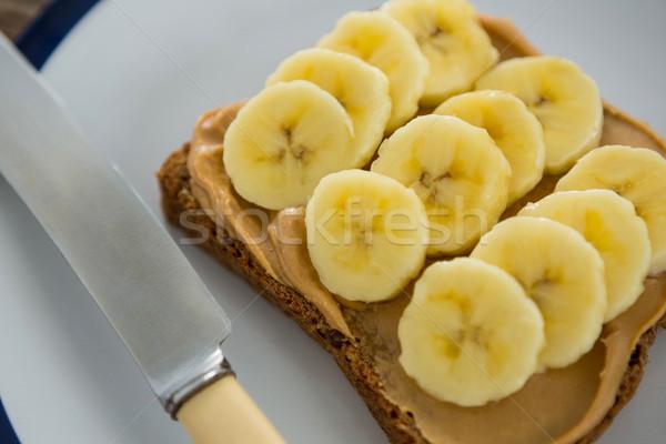 Sliced bananas spread on brown bread in plate Stock photo © wavebreak_media