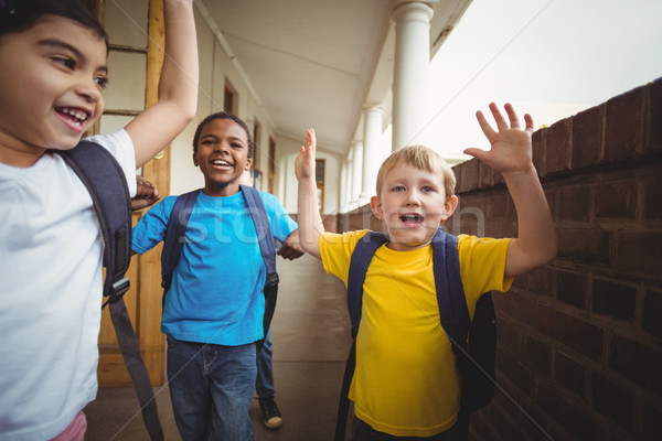Happy pupils leaving the classroom Stock photo © wavebreak_media