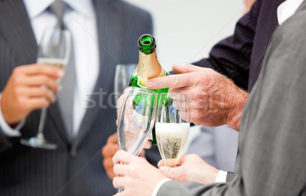 Biznesmen szampana biuro kobieta Zdjęcia stock © wavebreak_media