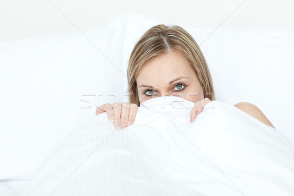 Stock photo: Beautiful woman hiding in her bed