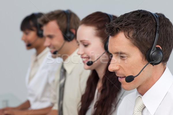 Atrakcyjny człowiek zestawu pracy call center więcej Zdjęcia stock © wavebreak_media