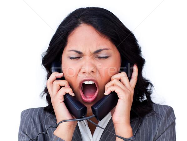 Csalódott üzletasszony felfelé telefon drótok fehér Stock fotó © wavebreak_media