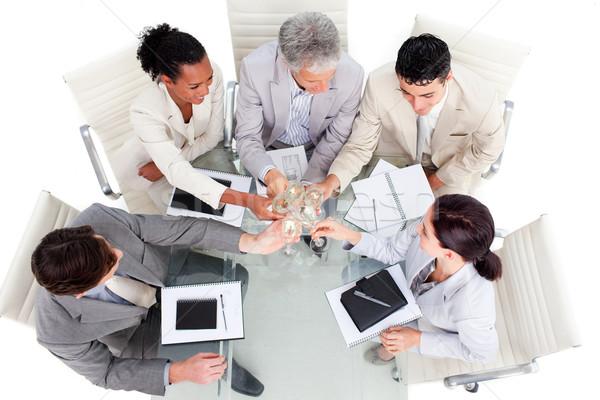 Jómódú üzleti csapat ünnepel siker fehér üzletember Stock fotó © wavebreak_media