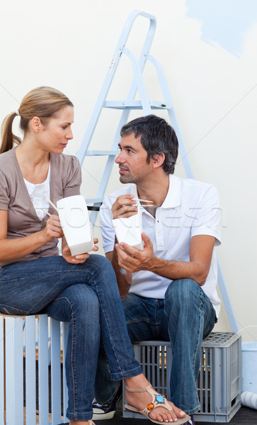 Couple eating while renovating their new house  Stock photo © wavebreak_media