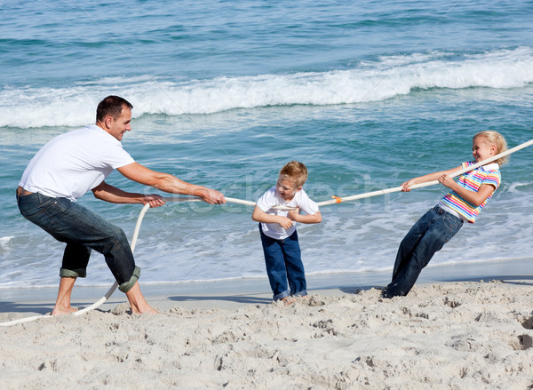 Happy family playing tug of war Stock photo © wavebreak_media