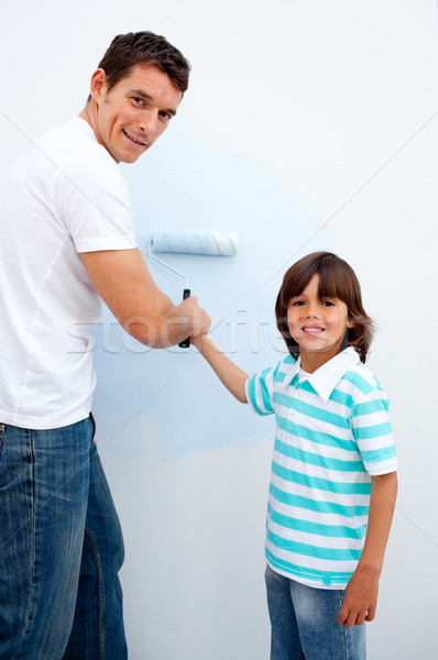 Happy father teaching his son how to paint  Stock photo © wavebreak_media