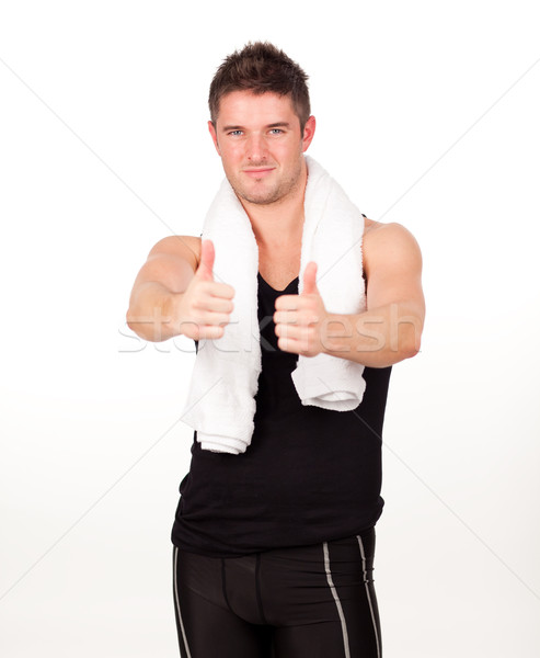 Sporting man with his thumbs up to the camera Stock photo © wavebreak_media