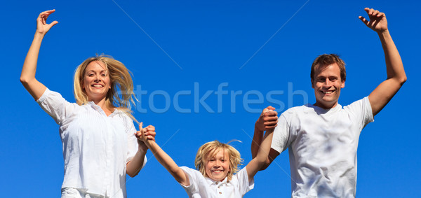 Stock photo: Cute family jumping in the air