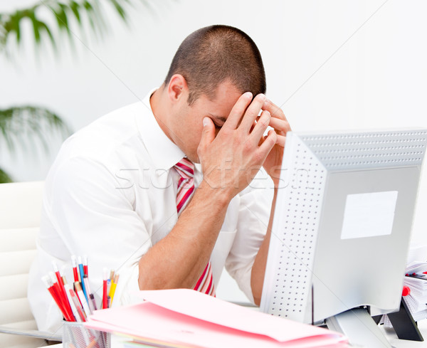 Frustrated businessman working at a computer  Stock photo © wavebreak_media