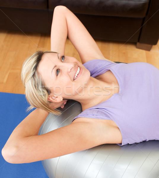 Smiling woman doing exercice  Stock photo © wavebreak_media