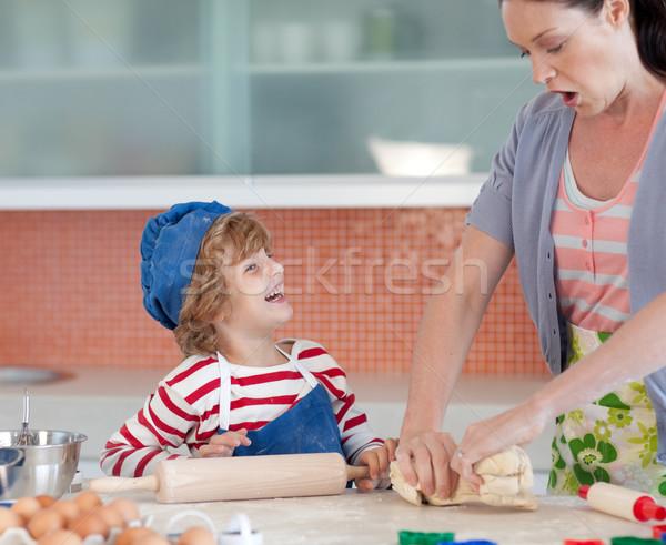 Laughing boy having fun with his mother baking cookies Stock photo © wavebreak_media
