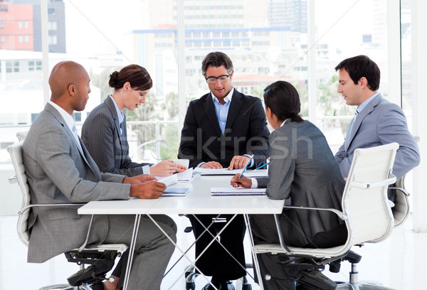 A diverse business group disscussing a budget plan in a meeting Stock photo © wavebreak_media