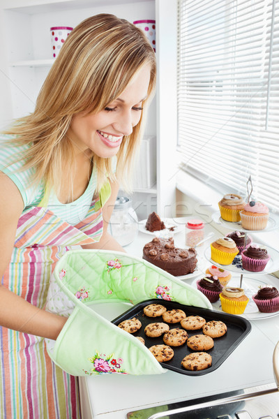 Charming woman baking in the kitchen at home Stock photo © wavebreak_media