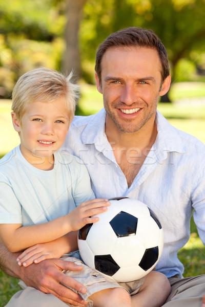 Hijo de padre partido de fútbol cielo sonrisa ojo cara Foto stock © wavebreak_media
