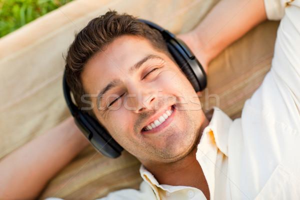 Foto stock: Moço · ouvir · música · parque · verde · diversão · dormir