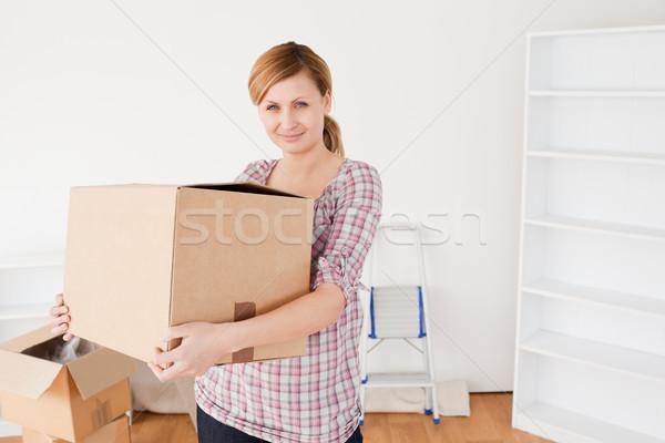 Attractive woman carrying cardboard boxes Stock photo © wavebreak_media