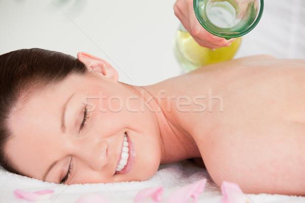 массажистка довольно назад цветы рук Сток-фото © wavebreak_media