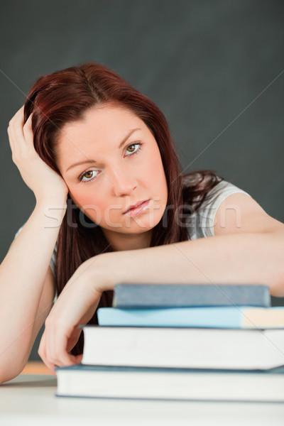 Fatigué étudiant avant-bras livres classe Photo stock © wavebreak_media