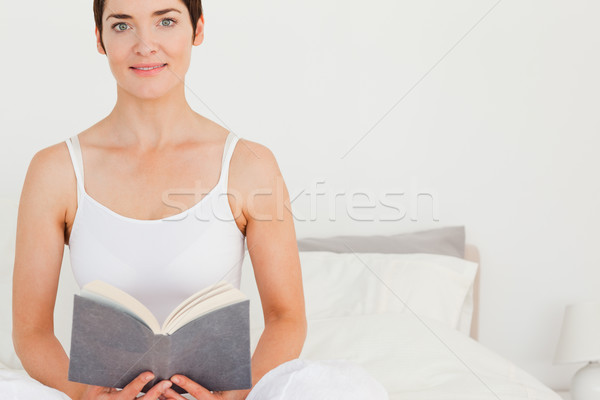 женщину книга спальня лице свет Сток-фото © wavebreak_media
