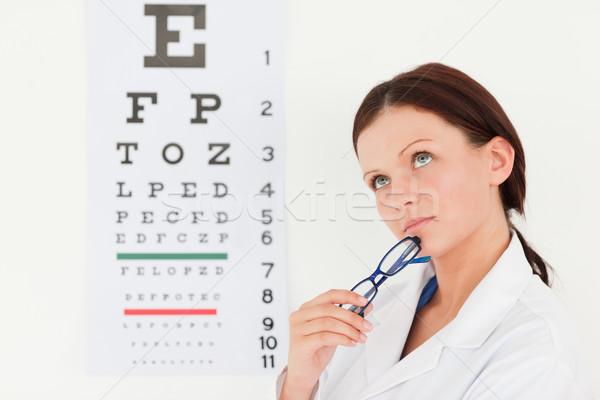 Femenino óptico examen de la vista oficina ojos trabajo Foto stock © wavebreak_media