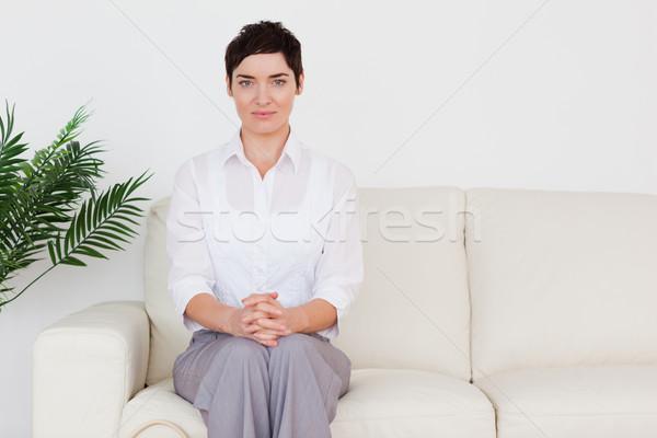Barna hajú nő ül kanapé váróterem virág Stock fotó © wavebreak_media