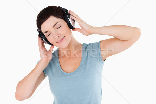 Close up of a woman enjoying some music against a white background Stock photo © wavebreak_media