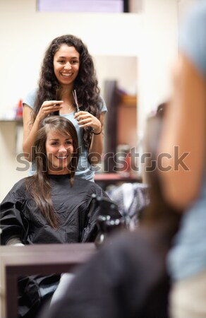 Woman combing the hair of a customer standing up Stock photo © wavebreak_media