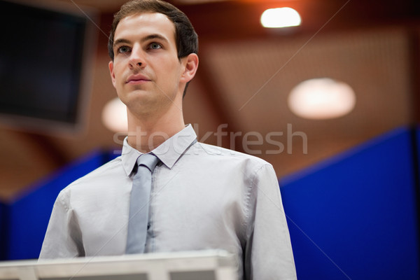 Young man doing a presentation looking away from the camera Stock photo © wavebreak_media