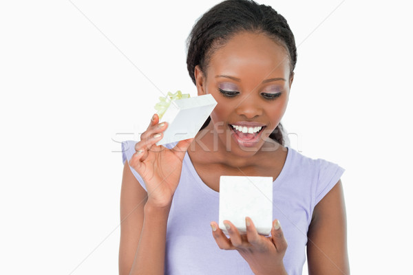 Close up of smiling woman being happy about what is in her present against a white background Stock photo © wavebreak_media