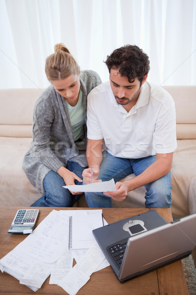 Portrait of a couple doing their accounting with a notebook in their living room Stock photo © wavebreak_media