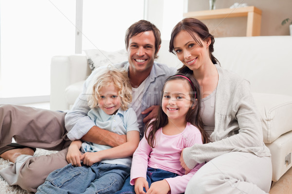 Family relaxing on a sofa in a living room Stock photo © wavebreak_media