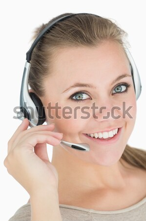 Close up of a smiling operator posing with a headset against a white background Stock photo © wavebreak_media