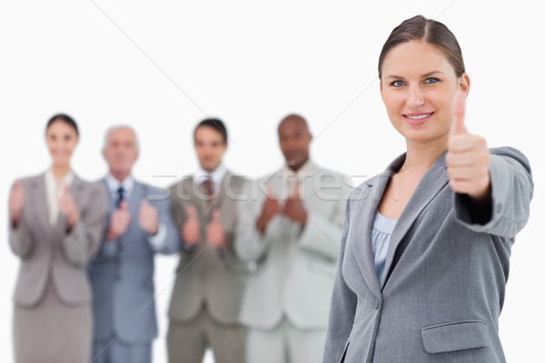 Imprenditrice pollice up colleghi dietro bianco Foto d'archivio © wavebreak_media