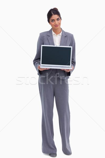 Female entrepreneur presenting screen of her laptop against a white background Stock photo © wavebreak_media