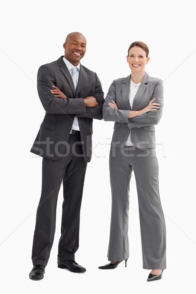 улыбаясь деловой человек женщину позируют рук заседание Сток-фото © wavebreak_media