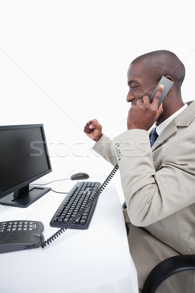 Portrait of a cheerful businessman making a phone call against a white background Stock photo © wavebreak_media