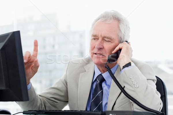Focused senior manager on the phone in his office Stock photo © wavebreak_media