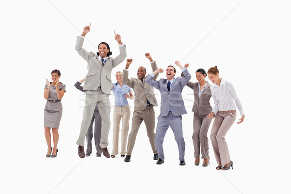 Very enthusiast business people jumping and raising their arms against white background Stock photo © wavebreak_media