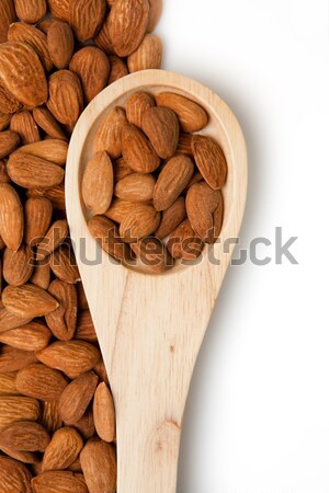 Wooden spoon with almonds in in a bowl Stock photo © wavebreak_media