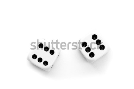 Black and white dices against a white background Stock photo © wavebreak_media